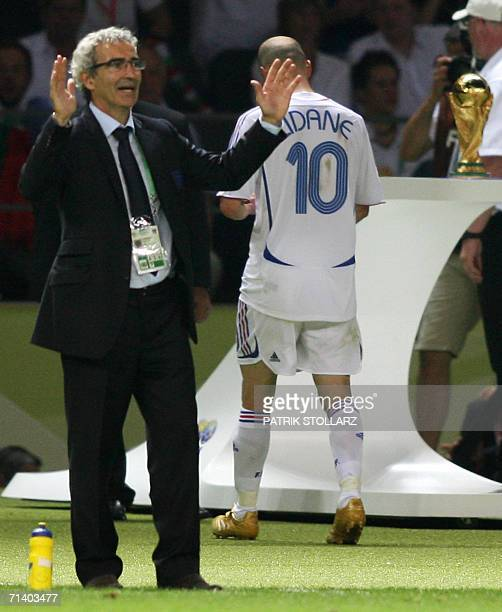 French head coach Raymond Domenech gestures in frustration as French midfielder Zinedine Zidane walks off the pitch after receiving a red card for...