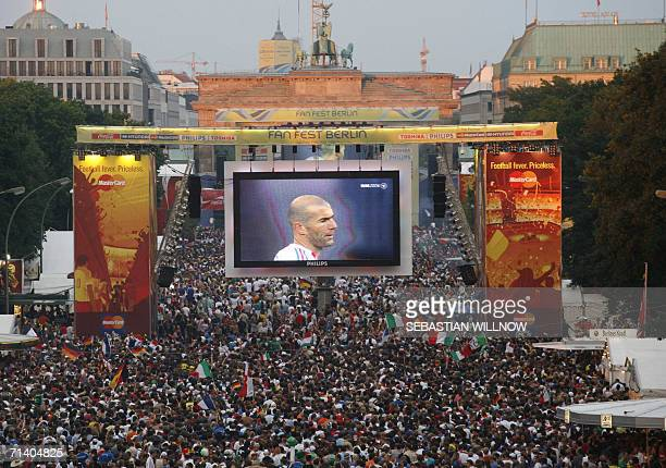 French midfielder Zinedine Zidane is displayed on a giant screen at the fan fest in Berlin during the World Cup 2006 final football game Italy...