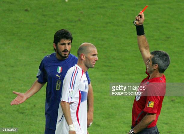 French midfielder Zinedine Zidane receives a red card from referee Horacio Elizondo of Argentina for headbutting Italian defender Marco Materazzi in...