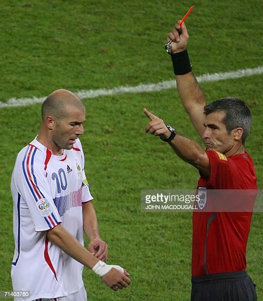 French midfielder Zinedine Zidane receives a red card from referee Horacio Elizondo of Argentina for headbutting Italian defender Marco Materazzi...