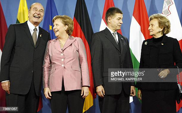 German Chancellor Angela Merkel and her husband Joachim Sauer pose with French President Jacques Chirac and his wife Bernadette at the Philharmonic...
