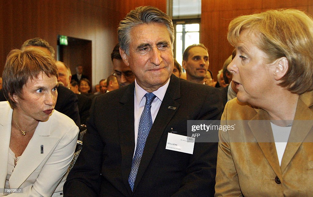 German Chancellor Angela Merkel talks with Laurence Parisot the leader of the French employers' federation MEDEF and the President of UNICE EU's...