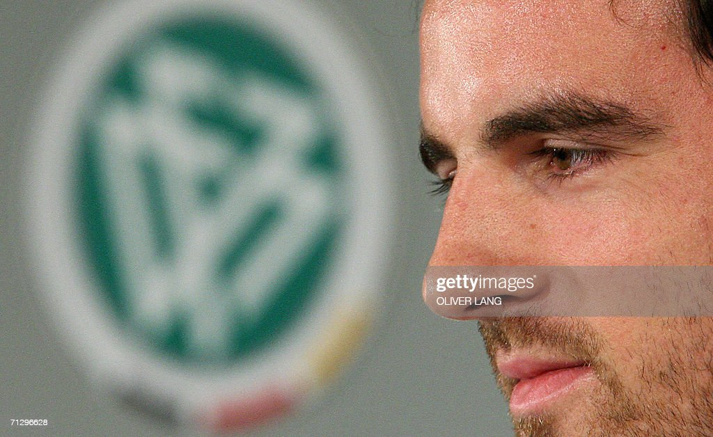 German defender Christoph Metzelder listens during a press conference at the ICC center in Berlin, 26 June 2006. Germany coach Jurgen Klinsmann said his ... - berlin-germany-german-defender-christoph-metzelder-listens-during-a-picture-id71296628