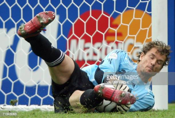 German goalkeeper Jens Lehmann makes the winning save against a penalty shot by Argentinian midfielder Esteban Cambiasso during a shootout at the end...
