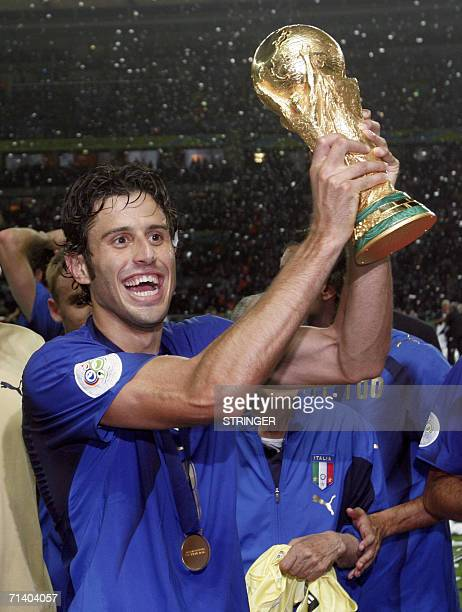Italian defender Fabio Grosso celebrates with the trophy after the World Cup 2006 final football game Italy vsFrance 09 July 2006 at Berlin stadium...