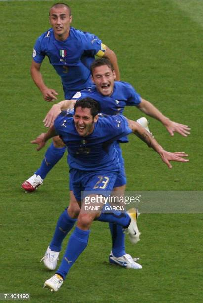Italian defender Marco Materazzi Italian midfielder Francesco Totti and Italian forward Alessandro Del Piero celebrate a goal during the World Cup...
