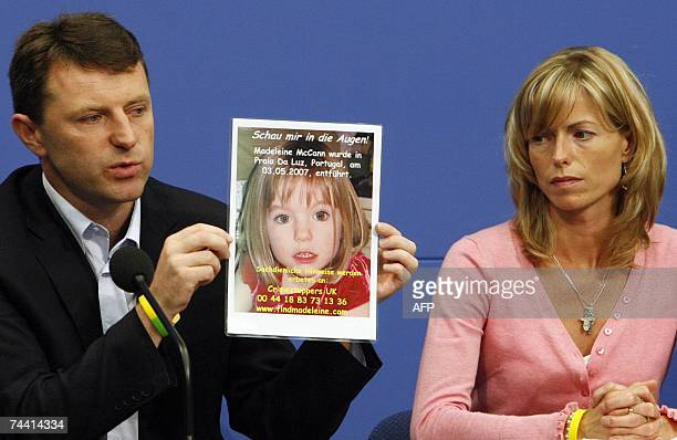 Kate and Gerry McCann parents of missing 4yearold British girl Madeleine McCann hold up a picture of their daughter during a press conference 06 June...