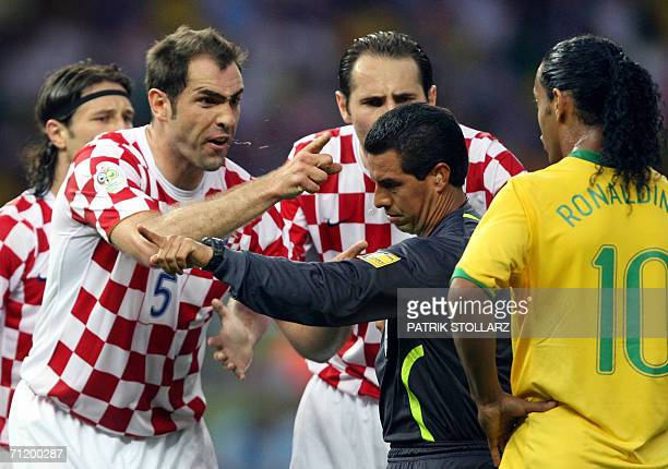 Mexican referee Ramirez Jose tries to stop Croatian defender Igor Tudor of arguing with Brazilian midfielder Ronaldinho during the World Cup 2006...