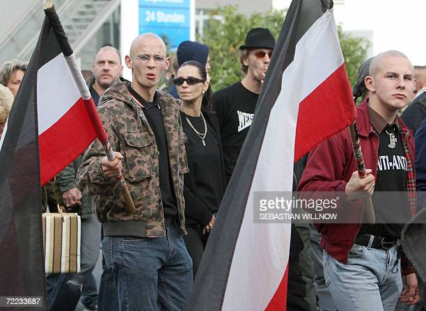 NeoNazis take part in a demonstration sponsored by the extreme right NPD nationalist party in Berlin 21 October 2006 The Demonstrators were...