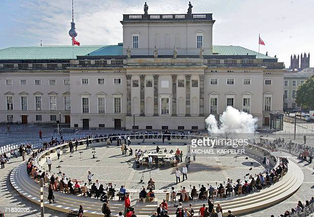 Participants of the first 'Table of Free Voices' of the 'Dropping Knowledge' initiative sit in a huge circle at Berlin's Bebelplatz place 09...