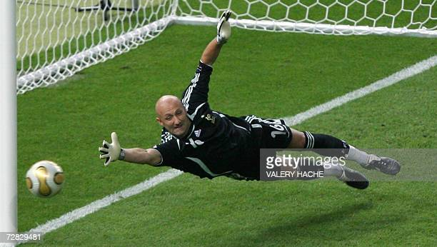 Picture taken 09 July 2006 of French goalkeeper Fabien Barthez diving for an Italian shot during the World Cup 2006 final football match between...