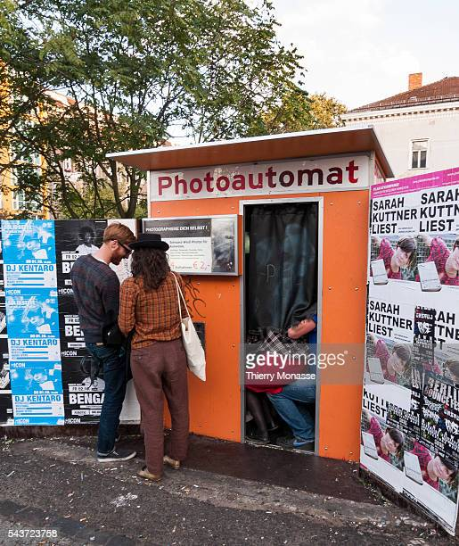Berlin Germany September 24 2009 Young enjoy aPhotoautomat in Warschauer Strasse