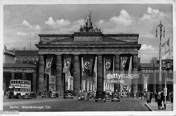 The Brandenburg Gate / Brandenburger Tor Nazi party flags cover the city gate Postcard stamped on rear 7 July 1941