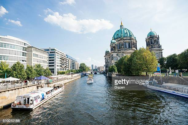 Berlin in summer, view over Spree river and sightseeing boats