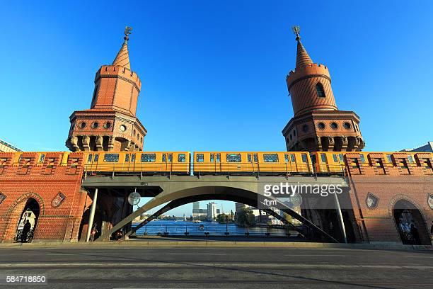 Berlin Kreuzberg - the 'Oberbaumbrücke' crossing Spree river, with a passing subway train