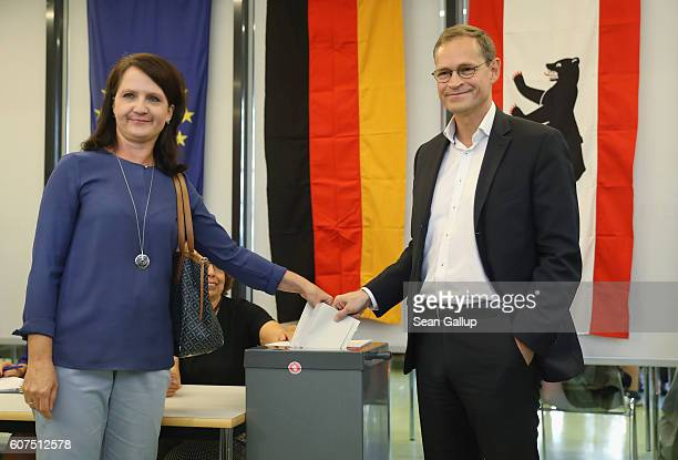Berlin Mayor and German Social Democrat Michael Mueller and his wife Claudia cast their ballots in Berlin state elections on September 18 2016 in...