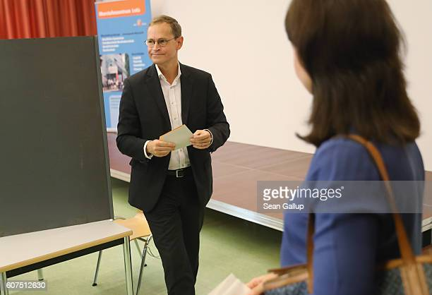 Berlin Mayor and German Social Democrat Michael Mueller prepares to cast his ballot in Berlin state elections on September 18 2016 in Berlin Germany...