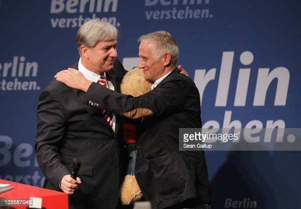 Berlin Mayor and incumbent candidate of the German Social Democrats Klaus Wowereit embraces his partner Joern Kubicki at an SPD electionnight...