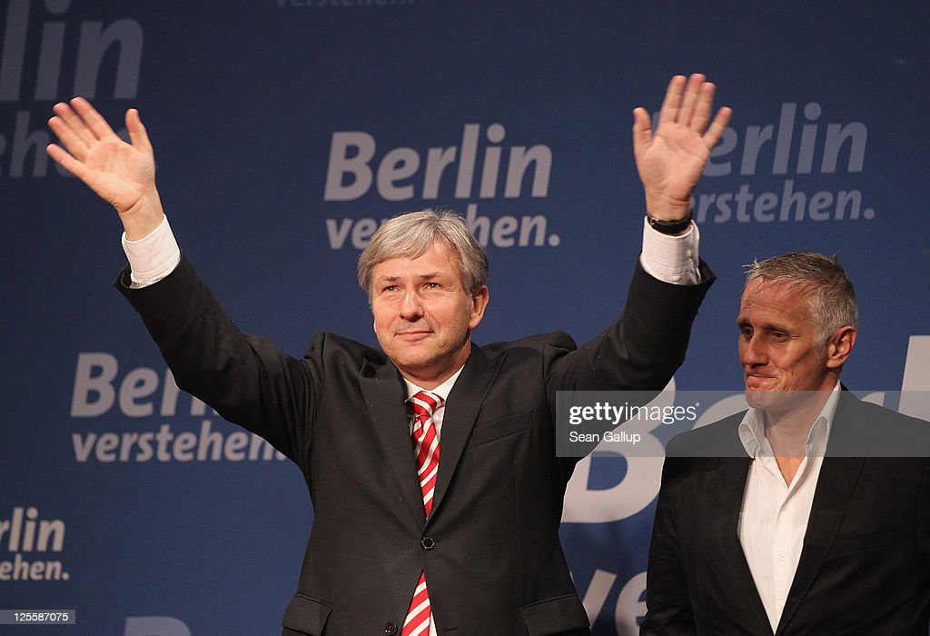 Berlin Mayor and incumbent candidate of the German Social Democrats (SPD) <a gi-track='captionPersonalityLinkClicked' href=/galleries/search?phrase=Klaus+Wowereit&family=editorial&specificpeople=213527 ng-click='$event.stopPropagation()'>Klaus Wowereit</a> (L) and his partner <a gi-track='captionPersonalityLinkClicked' href=/galleries/search?phrase=Joern+Kubicki&family=editorial&specificpeople=759997 ng-click='$event.stopPropagation()'>Joern Kubicki</a> celebrate at an SPD election-night gathering after initial exit polls gave the SPD 28.5% of the vote in Berlin city elections on September 18, 2011 in Berlin, Germany. With these results the SPD will most likely form a coalition government in Berlin with the German Greens Party (Buendnis 90/Die Gruenen).