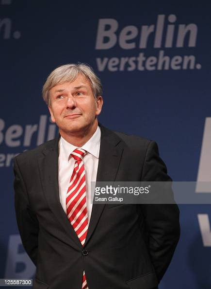 Berlin Mayor and incumbent candidate of the German Social Democrats Klaus Wowereit waits to address supporters at an SPD electionnight gathering...