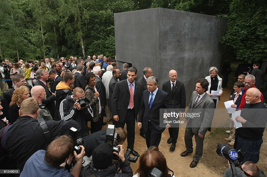 Berlin mayor and openly gay Klaus Wowereit (C) departs after viewing the just-inaugurated memorial to homosexual victims of the Nazis on May 27, 2008 in Berlin, Germany. The memorial, a large stone with a window that looks onto an image of two men kissing, commemorates the tens of thousands of gays imprisoned by the Nazis, including the estimated 15,000 sent to concentration camps. The memorial stands in the Tiergarten park close the to Holocaust Memorial.