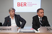 Berlin mayor Klaus Wowereit and Airport head Rainer Schwarz arrive to give a press conference following a meeting of the Governing Board of the new...