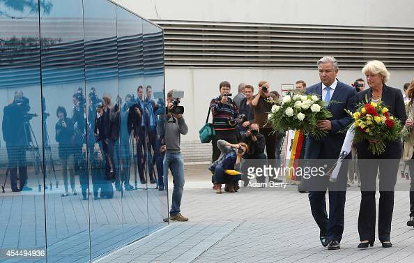 Berlin Mayor Klaus Wowereit and German State Minister Monika Gruetters place flowers on a monument dedicated to the over 200000 victims of the...
