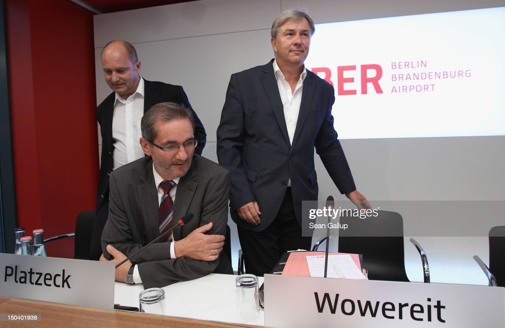 Berlin mayor <a gi-track='captionPersonalityLinkClicked' href=/galleries/search?phrase=Klaus+Wowereit&family=editorial&specificpeople=213527 ng-click='$event.stopPropagation()'>Klaus Wowereit</a> (R), Brandenburg Governor <a gi-track='captionPersonalityLinkClicked' href=/galleries/search?phrase=Matthias+Platzeck&family=editorial&specificpeople=605525 ng-click='$event.stopPropagation()'>Matthias Platzeck</a> (C) and Transport Ministry State Secretary Rainer Bomba arrive to give a press conference following a meeting of the Governing Board of the new Willy Brandt Berlin Brandenburg International Airport on August 16, 2012 in Berlin, Germany. Woes for the management of the airport construction are continuing, most recently with the revelation that a security worker employed at the construction site entrance is an Islamist convert named Florian L. who had contact to Islamic terrorists. Also, the FFB airport association that is in charge of the airport construction is having trouble getting further financial loans as estimated construction costs skyrocket from an orignal EUR 2.5 billion to EUR 5 billion. The airport was originally scheduled to begin operation in June, though the opening is delayed at least until March, 2013, supposedly because installation of the fire security system was far behind schedule. The new aiport is supposed to replace Berlin's current Tegel and Schoenefeld airports, though analysts say that Tegel will have to remain open because the new airport will lack sufficient capacity.
