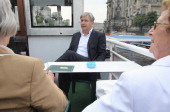 Berlin Mayor Klaus Wowereit chats with senior citizens while on a boat tour in the city center on the Spree river on August 17 2011 in Berlin Germany...