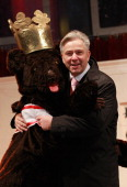 Berlin Mayor Klaus Wowereit gets a hug from a Berlin bear at the official opening of the Christmas Market at Gendarmenmarkt on November 22 2010 in...