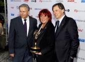 Berlin mayor Klaus Wowereit producer Regina Ziegler and producer Michael Smeaton attend the '40th International Emmy Awards Semi Final Hosting'...
