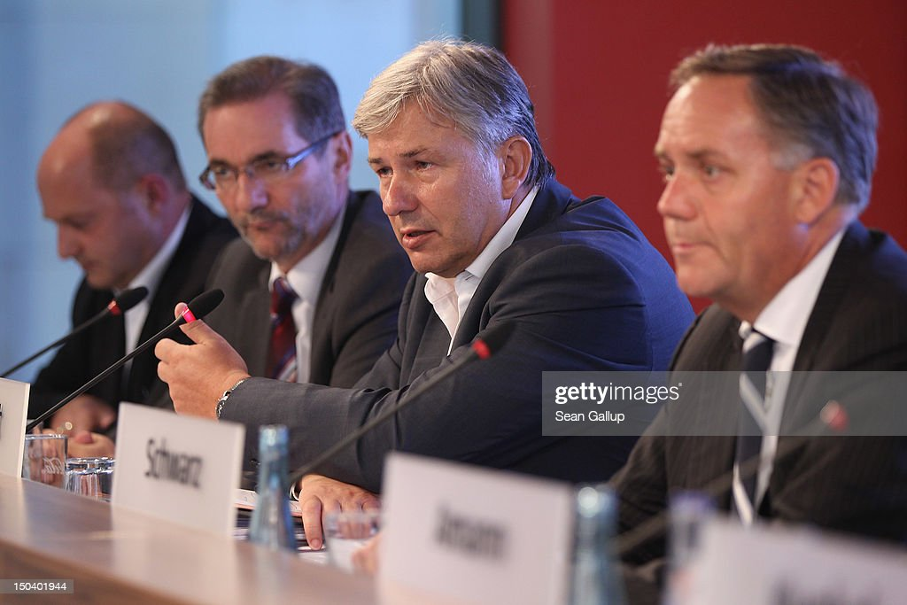 Berlin Mayor <a gi-track='captionPersonalityLinkClicked' href=/galleries/search?phrase=Klaus+Wowereit&family=editorial&specificpeople=213527 ng-click='$event.stopPropagation()'>Klaus Wowereit</a> speaks as Transport Ministry State Secretary Rainer Bomba (L), Brandenburg Governor <a gi-track='captionPersonalityLinkClicked' href=/galleries/search?phrase=Matthias+Platzeck&family=editorial&specificpeople=605525 ng-click='$event.stopPropagation()'>Matthias Platzeck</a> (2nd from L) and Airport head Rainer Schwarz look on at a press conference following a meeting of the Governing Board of the new Willy Brandt Berlin Brandenburg International Airport on August 16, 2012 in Berlin, Germany. Woes for the management of the airport construction are continuing, most recently with the revelation that a security worker employed at the construction site entrance is an Islamist convert named Florian L. who had contact to Islamic terrorists. Also, the FFB airport association that is in charge of the airport construction is having trouble getting further financial loans as estimated construction costs skyrocket from an orignal EUR 2.5 billion to EUR 5 billion. The airport was originally scheduled to begin operation in June, though the opening is delayed at least until March, 2013, supposedly because installation of the fire security system was far behind schedule. The new aiport is supposed to replace Berlin's current Tegel and Schoenefeld airports, though analysts say that Tegel will have to remain open because the new airport will lack sufficient capacity.