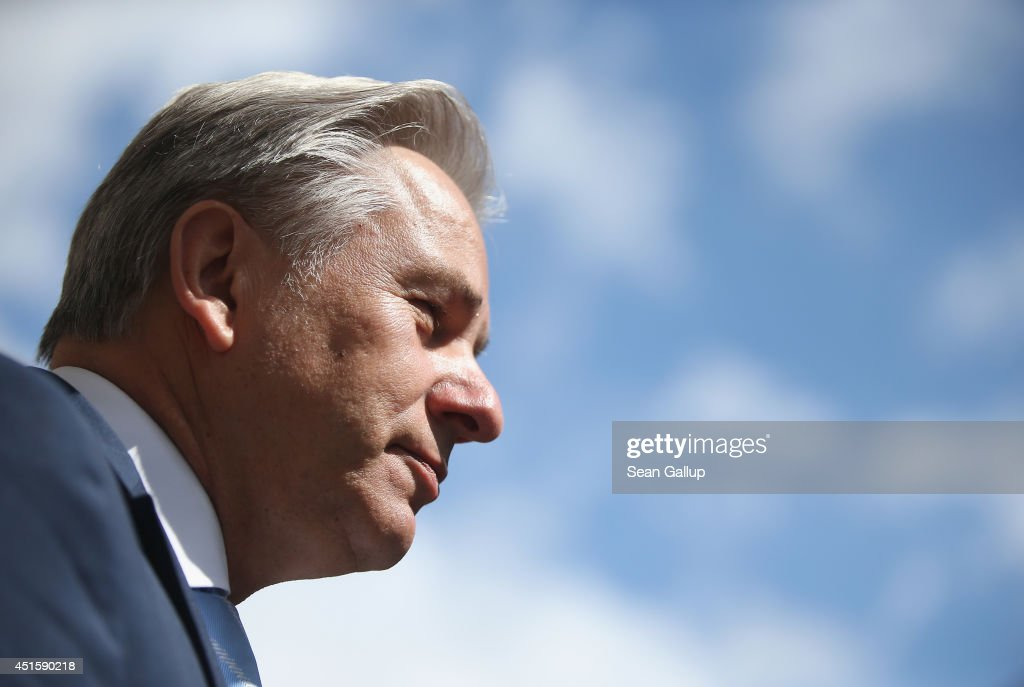 Berlin Mayor <a gi-track='captionPersonalityLinkClicked' href=/galleries/search?phrase=Klaus+Wowereit&family=editorial&specificpeople=213527 ng-click='$event.stopPropagation()'>Klaus Wowereit</a> speaks to a journalist as a blue sky is visible behind following an event on July 1, 2014 in Berlin, Germany. Wowereit is on the Governing Board of the new BER Willy Brandt Berlin Brandenburg International Airport. The airport was originally due to open in 2011 and cost EUR 1.7 billion, though problems in its fire safety system have resulted in delays with no final date yet set for its completion and costs have ballooned to at least EUR 5.1 billion.