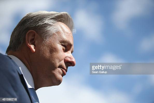 Berlin Mayor Klaus Wowereit speaks to a journalist as a blue sky is visible behind following an event on July 1 2014 in Berlin Germany Wowereit is on...