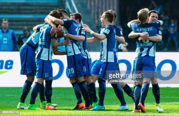 Berlin players celebrate after Berlin's US defender John Anthony Brooks scored the opening goal during the German first division Bundesliga football...