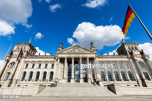 Berlin Reichstag building (german parliament building) with german flag