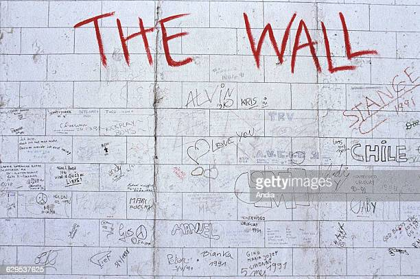 Berlin Remains of the Berlin Wall Painted signs East side 1990 East Side Gallery Fresco mural graffiti Fresco refering to the album and film 'The...