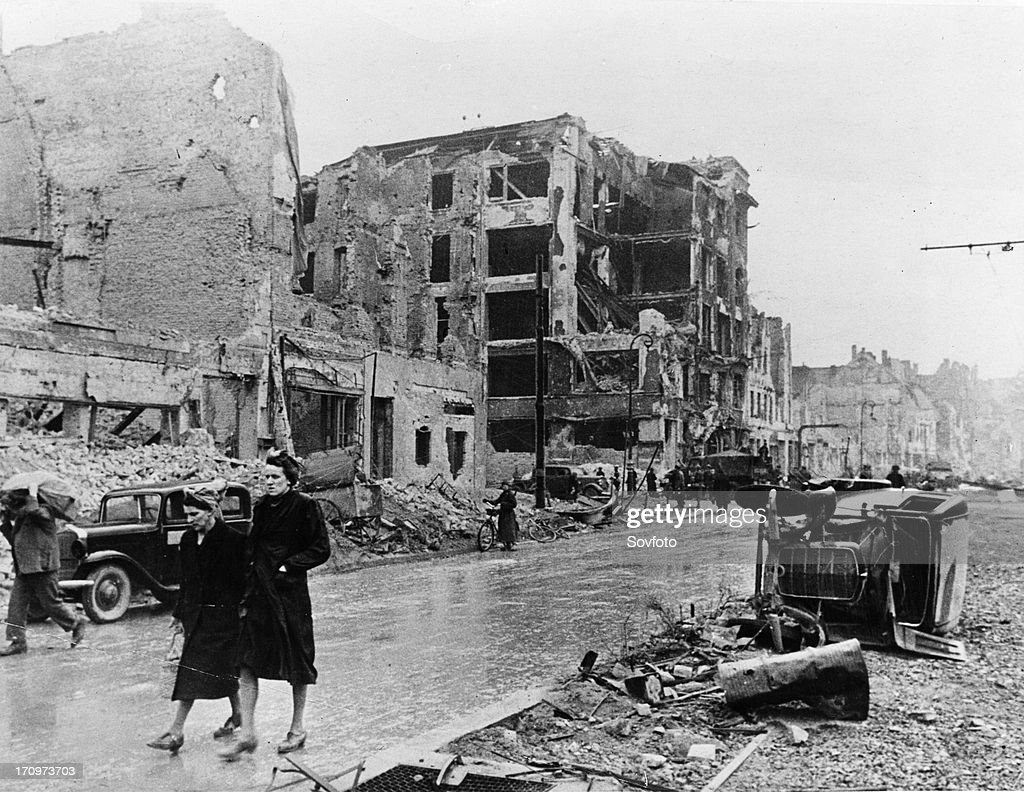 Berlin residents walk through the ruins of the city after the city was taken by the soviet red army may 1945 world war 2