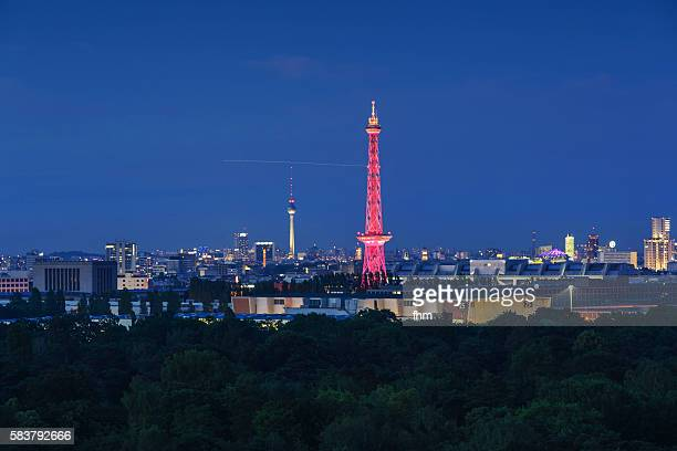 Berlin skyline at blue hour - with TV-Tower and Radiotower in red illumination
