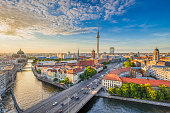 Aerial view of Berlin skyline with famous TV tower and Spree river in beautiful evening light at sunset, Germany