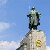 Statue of a Soviet soldier at Soviet War Memorial in Berlin Tiergarten, Germany. Erected to commemorate the soldiers of the Soviet Armed Forces who died during the Battle of Berlin.