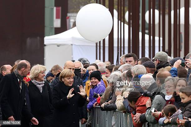 Berlin Wall Memorial Director Axel Klausmeier Federal Government Commissioner for Culture and the Media Monika Gruetters and German Chancellor Angela...