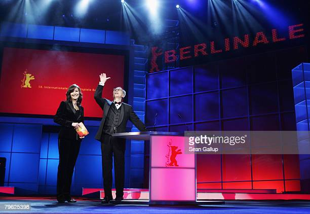 Berlinale director Dieter Kosslick addresses the audience as host Katrin Bauerfeind looks on during the Opening Ceremony as part of the 58th...