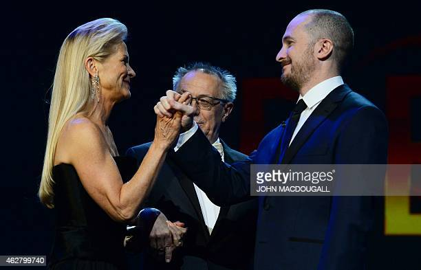 Berlinale director Dieter Kosslick looks on as US director and President of the Berlinale International Jury Darren Aronofsky greets US film producer...