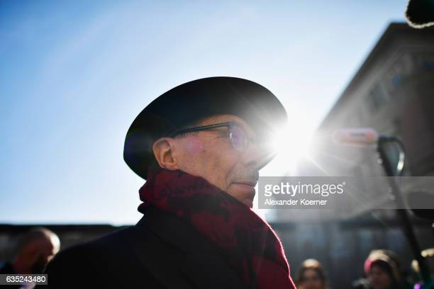 Berlinale director Dieter Kosslick poses in front of the Berlin wall in protest against barriers and walls in a simple gesture towards peace and...
