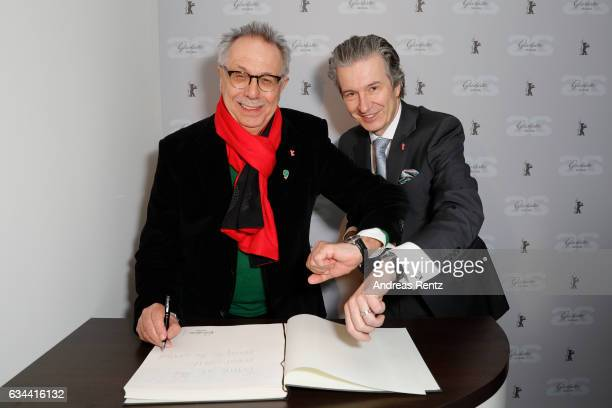 Berlinale Festival Director Dieter Kosslick and CEO of Glashuette Original Thomas Meier pose in the Golden Bear Lounge by Glashuette Original on...