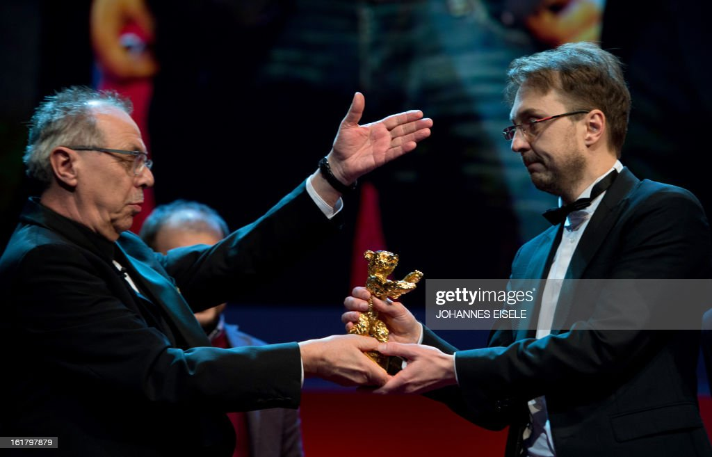 Berlinale Festival Director Dieter Kosslick hands over the Golden Bear for the Best Film to Romanian director Calin Peter Netzer for his movie...