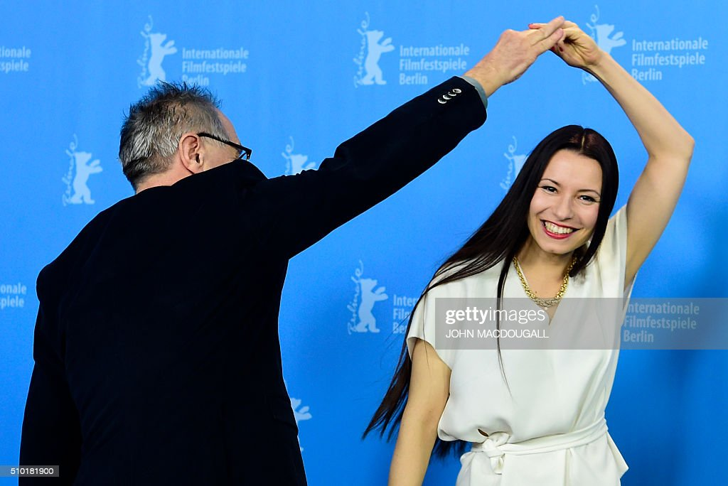 Berlinale festival director Dieter Kosslick (L) pretends to dance with German director Anne Zohra Berrached at a photocall for the film '24 Weeks' (24 Wochen) during the 66th Berlinale Film Festival in Berlin on February 14, 2016. Eighteen pictures vie for the Golden Bear top prize at the event which runs from February 11 to 21, 2016. / AFP / John MACDOUGALL