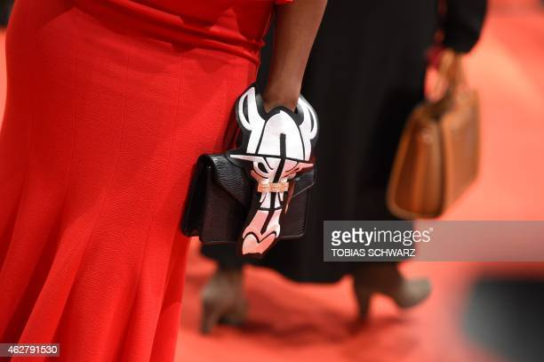 A Berlinale guest carries her handbag as she arrives for the opening of the Berlinale International Film Festival in Berlin February 5 2015 The 65th...