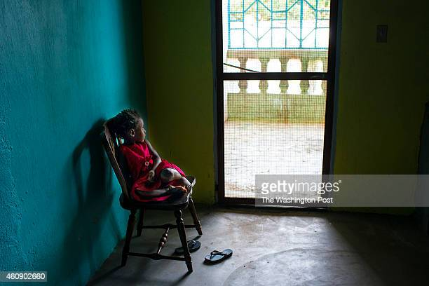 Berlinda Clark sits by a door unable to interact with other people because she is under observation on Sunday September 21 2014 in Monrovia Liberia...